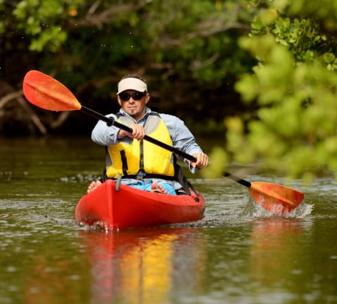 image of a man on a kayak overjoyed with his new Columbia SC based Recreational insurance